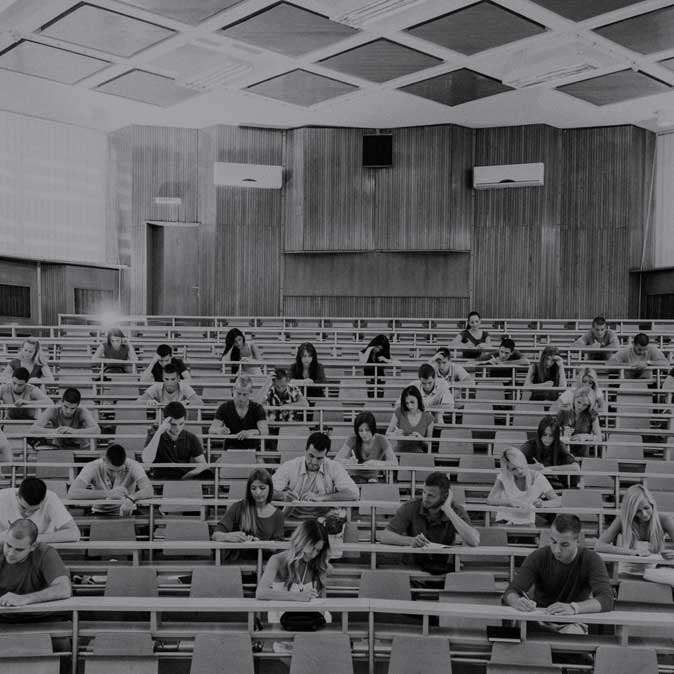 Image of students in a sparsely populated college classroom