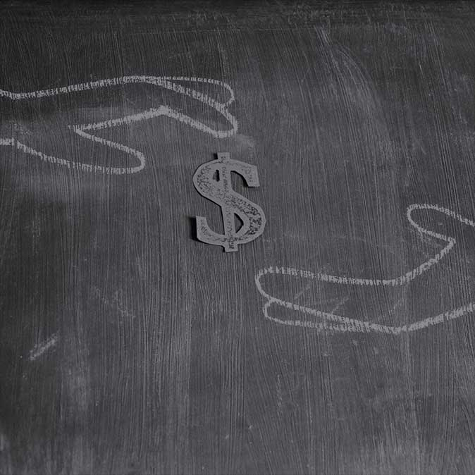 Dark chalkboard background with hand drawn chalk outlines of hands reaching for a symbol of the Dollar