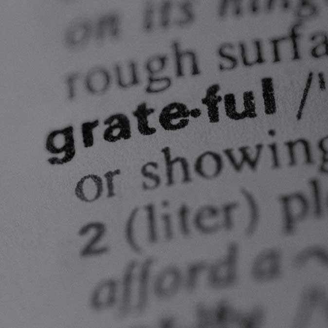 Close-up dictionary image of the word 'grateful'