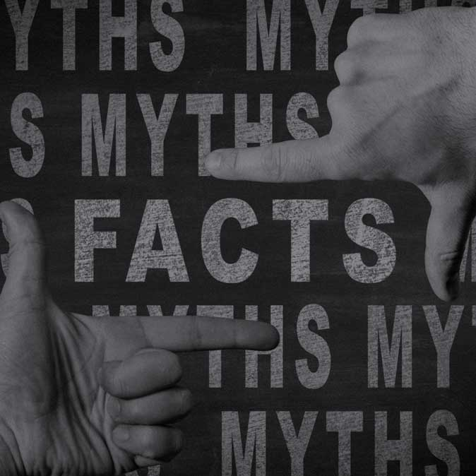 Two hands with their index finger and thumbs framing the words 'Facts' and 'Myths' in the background.